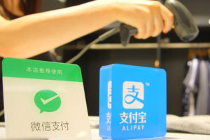 Alipay and WeChat pay signs at point of sale in Chinese store