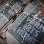 APAC News Sydney Daily Telegraph coronvirus headline stack of papers on ground