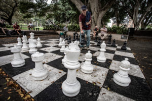 APAC News people playing outdoor chess at Sydney's Hyde Park